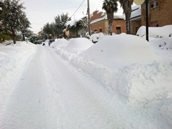 sg main street with cars under snow